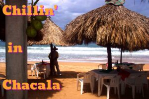 A man in a sombrero looks over the sea from the beach in Chacala mexico (Chillin' in Chacala)