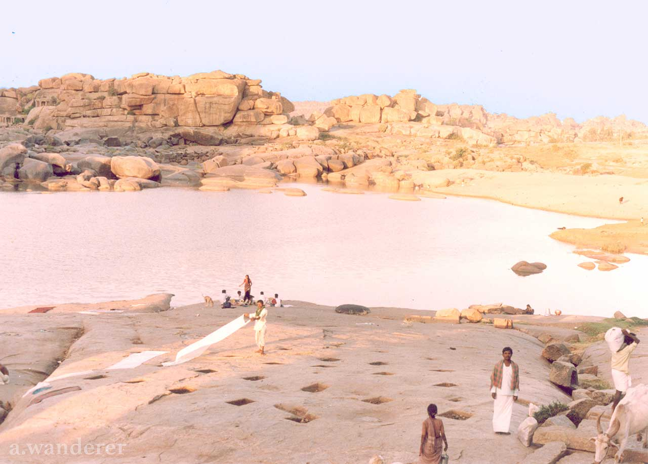 Locals do laundry on the banks of the Tungabhadra River in Hampi, India