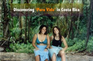 College age girls sitting at Cahuita National Park in front of a jungle backdrop