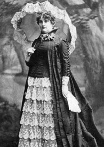 Famous Denver Madame Mattie Silks poses with a with a parasol