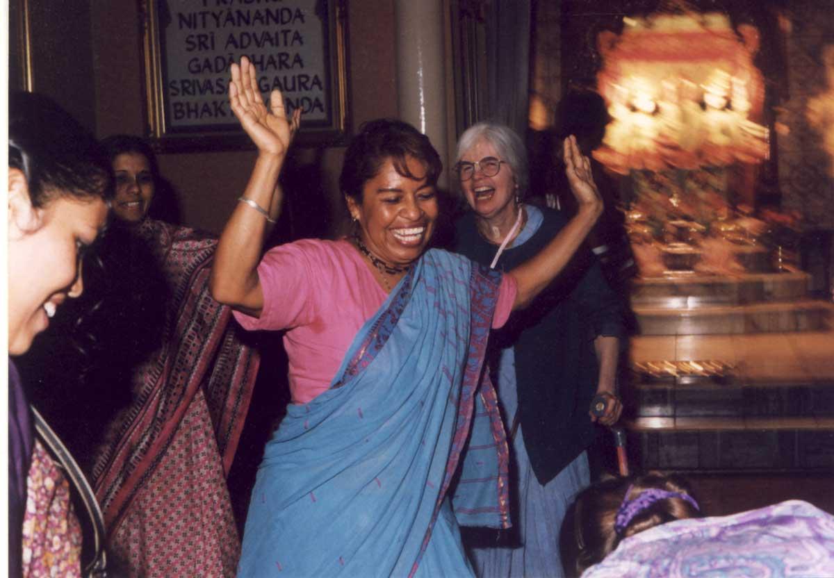 Hare Krishna devotees dancing in the Denver temple