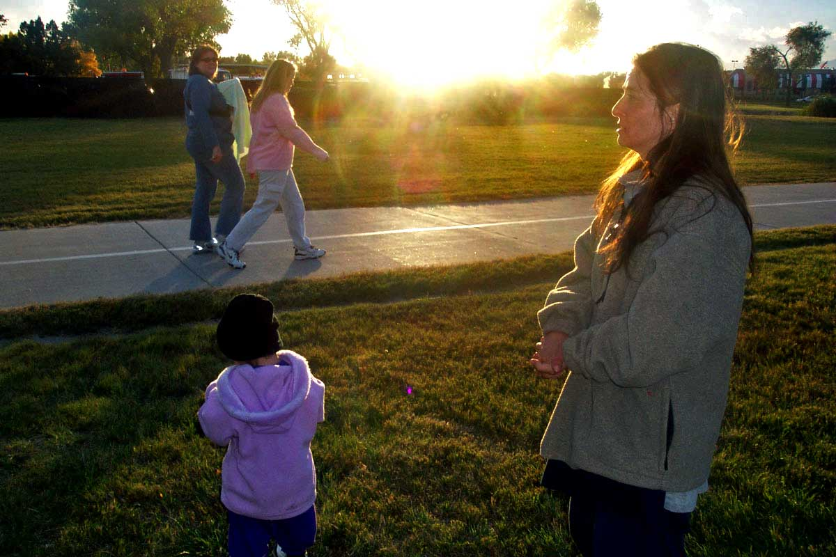 Woman with toddler as sunsets
