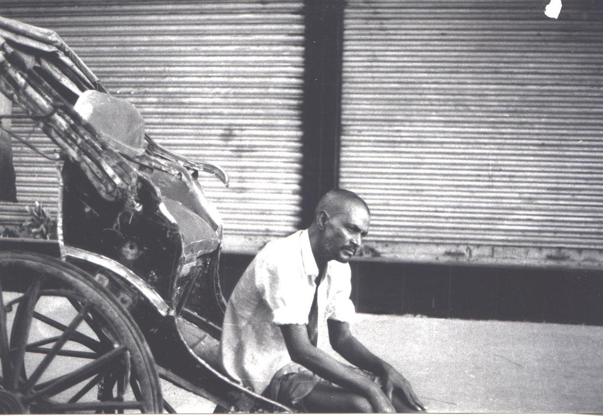 A rickshaw wallah resting