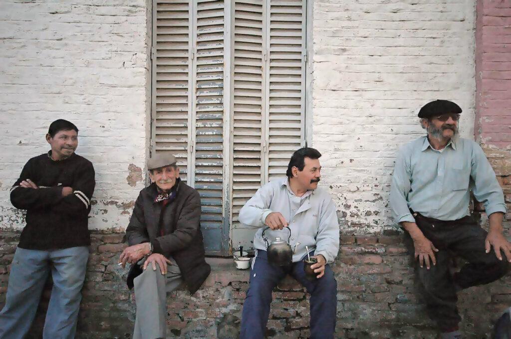 Four men drinking yerba mate